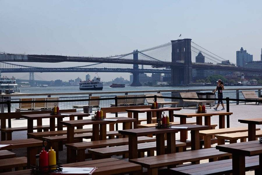 Watermark Bar & Lounge Outdoor seating with views of the Brooklyn Bridge