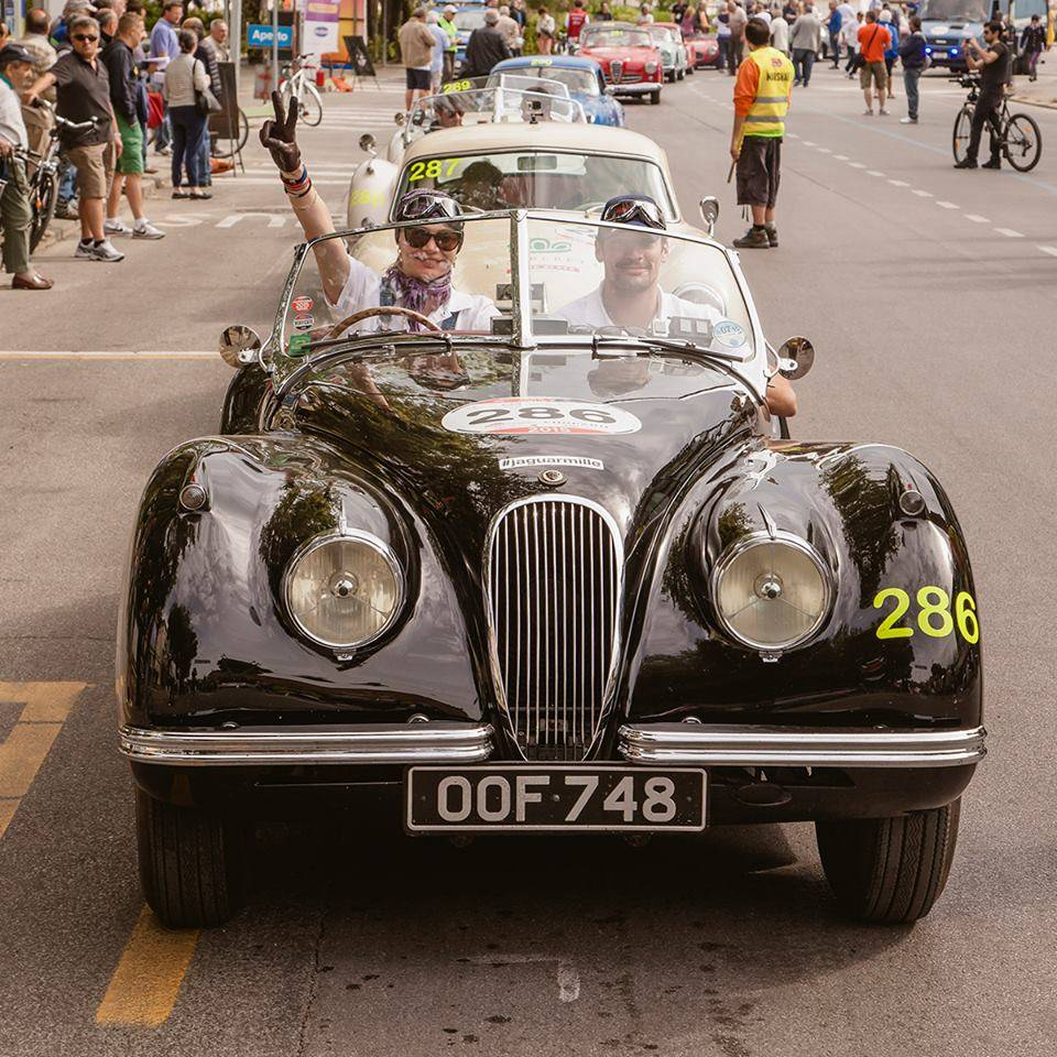 Model driver, model navigator. Jodie Kidd and David Gandy in their XK120, day two of Mille Miglia 2015