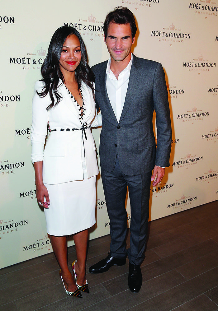 LOS ANGELES, CA - MARCH 07:  Actress Zoe Saldana (L) and tennis player Roger Federer attend the Moet & Chandon toast to honor brand ambassador Roger Federer's history-making 1,000th career win at Four Seasons Hotel Los Angeles at Beverly Hills on March 7, 2015 in Los Angeles, California.  (Photo by Joe Scarnici/Getty Images for Moet & Chandon)
