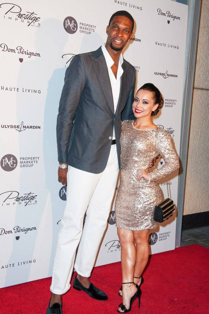 Basketball player Chris Bosh and his wife Adrienne Bosh attend Haute Living Haute 100 Dinner presented by Dom Perignon at Tamarina at Brickell World Plaza on May 6, 2015 in Miami, Florida.  (Photo by Sergi Alexander/Getty Images for Haute Living)