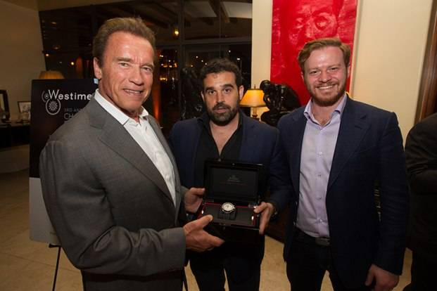 Arnold Schwarzenegger, Haute Living publisher Seth Semilof and Greg Simonian, by Peter Grigsby