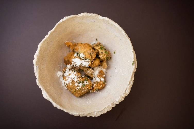 Paula LeDuc Catering's Deep Fried Coq Au Vin with tarragon & red wine butter