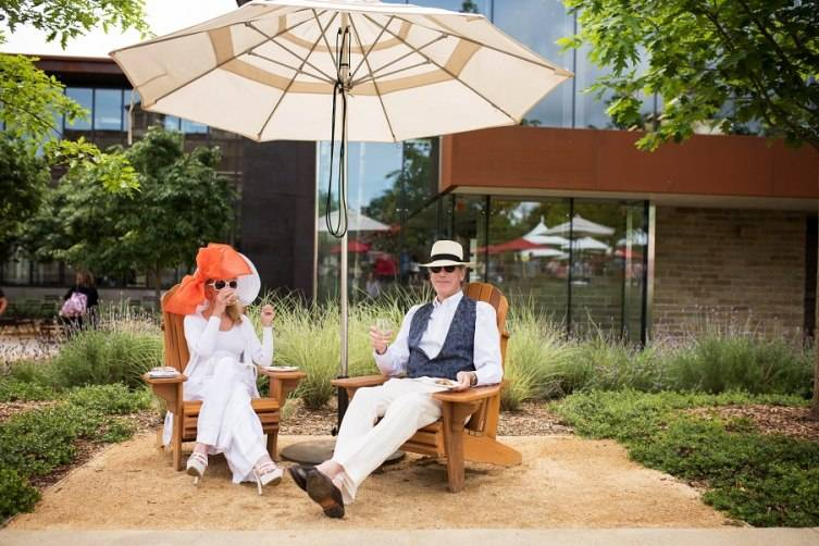 A stylish couple takes a break to enjoy the moment during the 2015 HALL Cab Cookoff