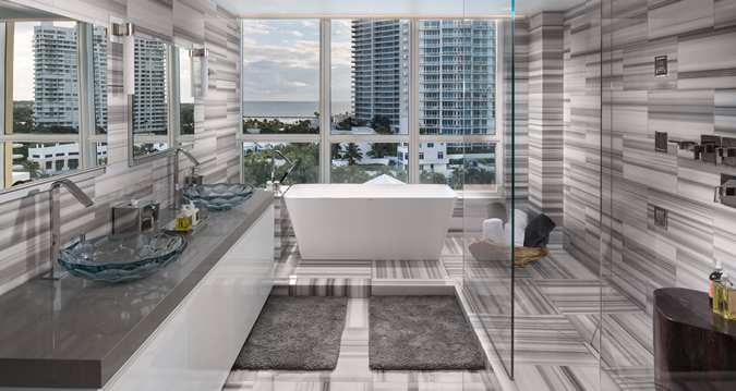 Presidential suite includes marble bathrooms with whirlpool tub.