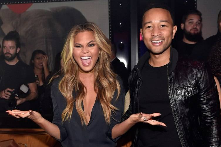 LAS VEGAS, NV - MAY 16:  Model Chrissy Teigen (L) and singer John Legend appear at 1 OAK Nightclub at The Mirage Hotel & Casino for a special Pre-Billboard Music Award celebration on May 16, 2015 in Las Vegas, Nevada.  (Photo by David Becker/WireImage) *** Local Caption *** Chrissy Teigen; John Legend