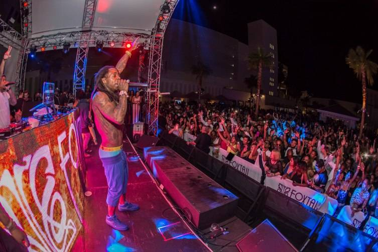 Lil Wayne performs to a packed crowd at the hottest After Dark party in Vegas inside Foxtail Pool Club