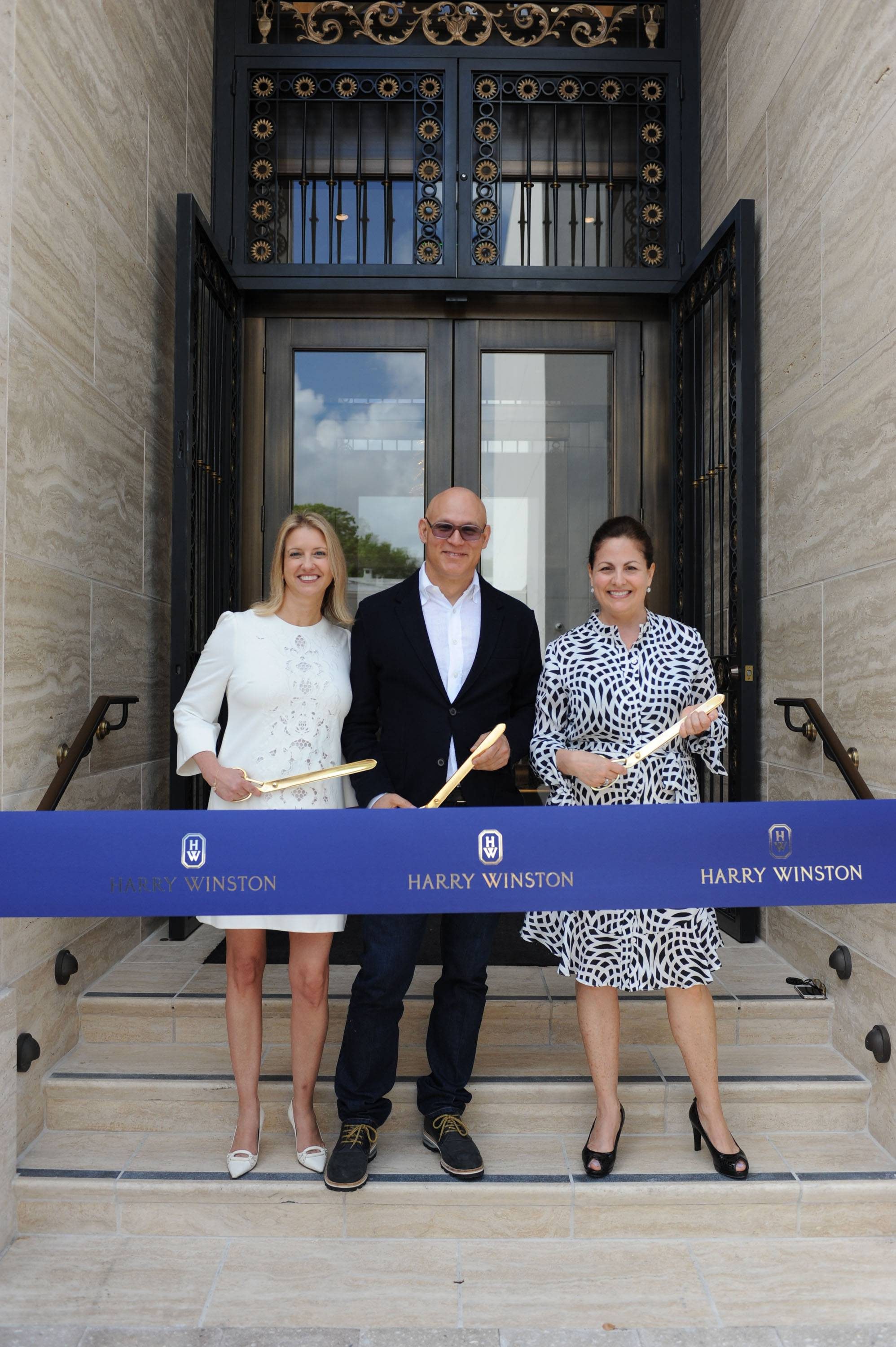 Mary Cunsolo Craig Robins  Laurie Adorno cutting ribbon