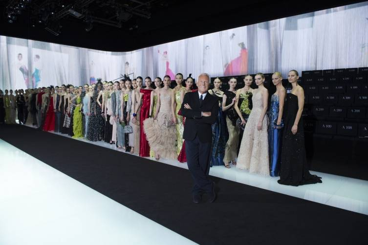 Giorgio Armani and his models