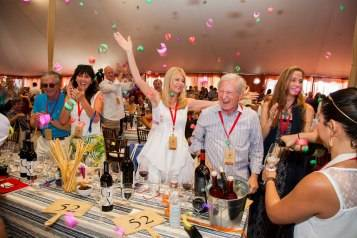 Celebrating the winning bid of lot number 1 at Auciton Napa Valley 2014. Photo by <a href=