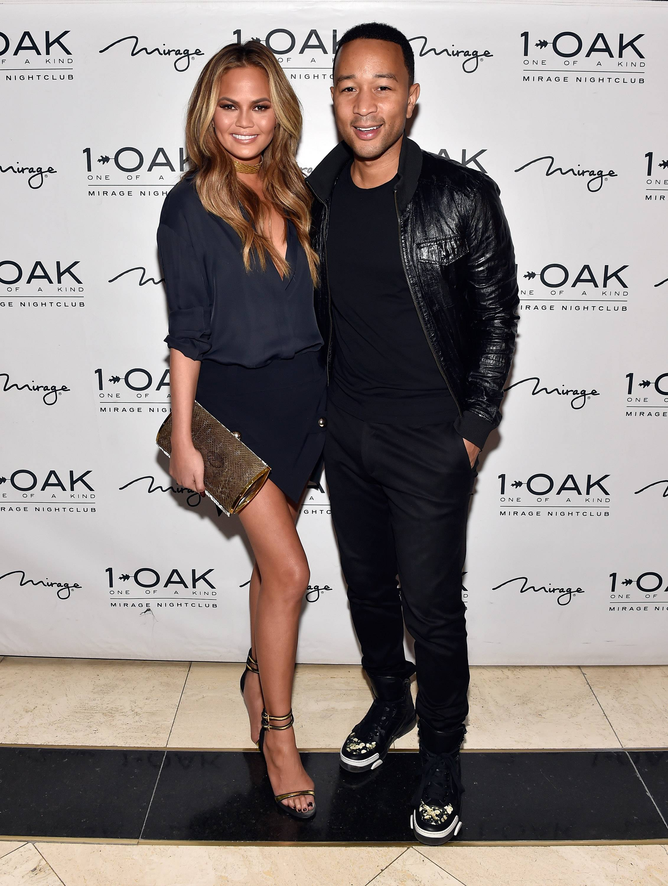 LAS VEGAS, NV - MAY 16:  Model Chrissy Teigen (L) and singer John Legend arrive at 1 OAK Nightclub at The Mirage Hotel & Casino for a special Pre-Billboard Music Award celebration on May 16, 2015 in Las Vegas, Nevada.  (Photo by David Becker/WireImage) *** Local Caption *** Chrissy Teigen; John Legend