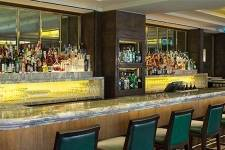 wpid-Jumeirah-Group-Jumeirah-Carlton-Tower-Rib-Room-Long-Bar-View-hero.jpg
