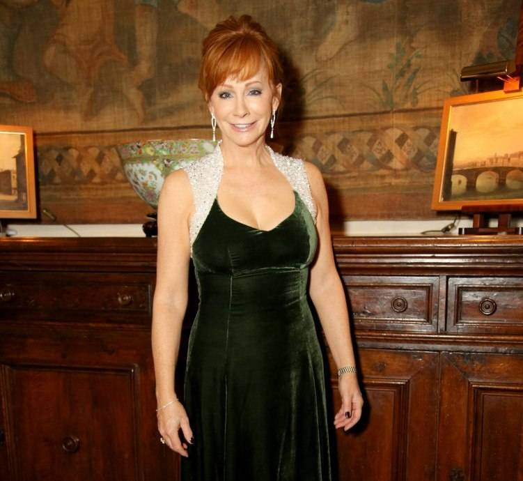 Reba McEntire attends a cocktail reception held at Palazzo Spini Feroni, built in the 13th Century and home to the Museo Salvatore Ferragamo, the museum and shop featuring the fashion designs of Ferragamo, the shoemaker to the stars, during Celebrity Fight Night In Italy