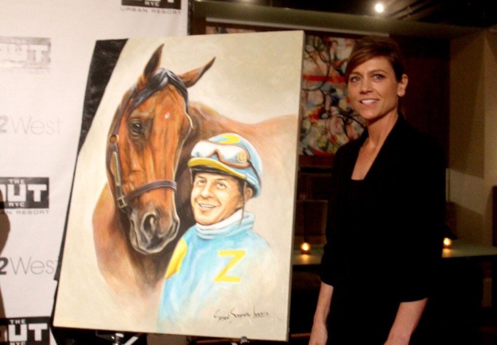Espinoza with American Pharoah by artist Susan Sommer-Luarca.