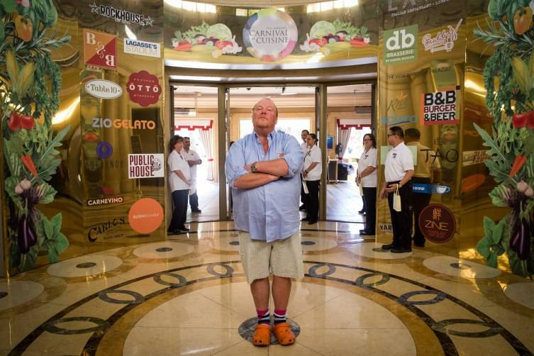 Chef Mario Batali stands at the entrance to the 7th Annual Carnival of Cuisine at the Palazzo.