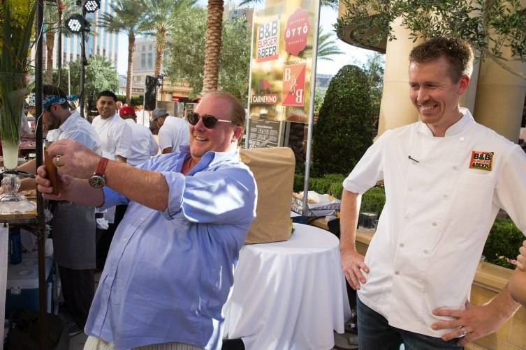 Chef Mario Batali takes a selfie with Chef Jason Neve at Carnival of Cuisine at The Palazzo