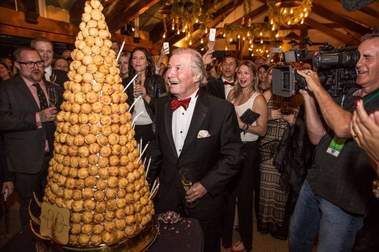Chef Jacques Pépin admires a croquembouche at his 80th birthday celebration.