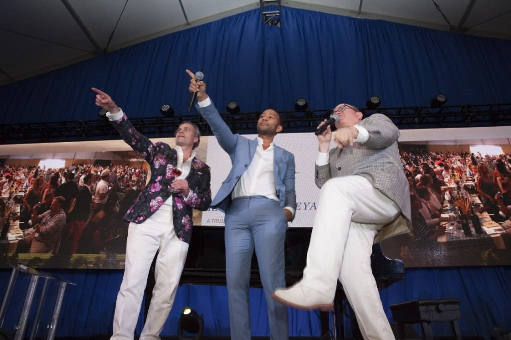 John Legend joins auctioneer Fritz Hatton auction off Lot Number 31 at Auction Napa Valley 2015. Photo by Jason Tinacci