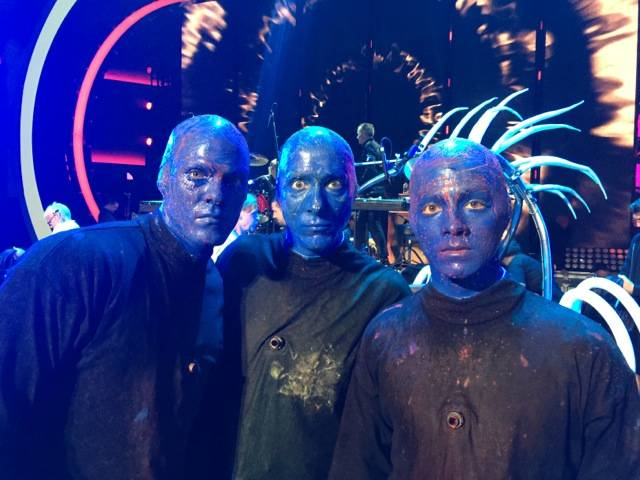 From left: Alan Ritchson, a Blue Man and Joe Jonas as honorary members of Blue Man Group.