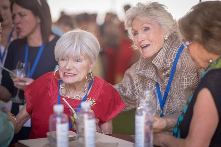 Margrit Mondavi and Molly Chappellet talking with bidders during Auction Napa Valley at Meadowood.