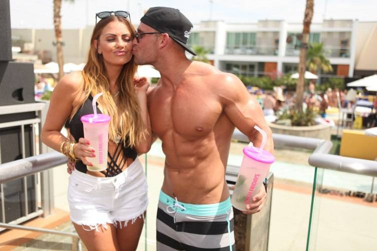 Michelle Money and Cody Sattler get affectionate at Ditch Fridays