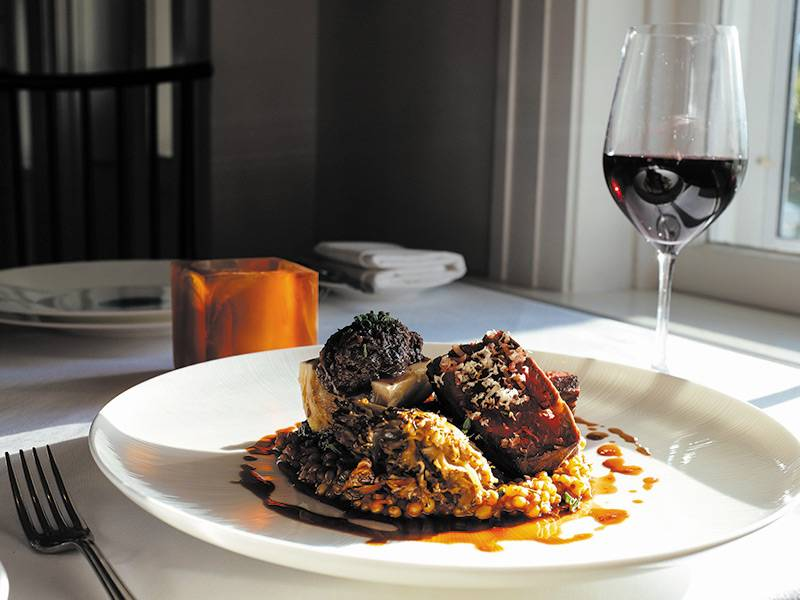 """""""A tasting of Neiman Ranch Beef with roasted striploin, roasted bone marrow and oxtail marmalade. Served with wheatberries, swiss chard, smoked maitake mushroom and bordolaise"""""""