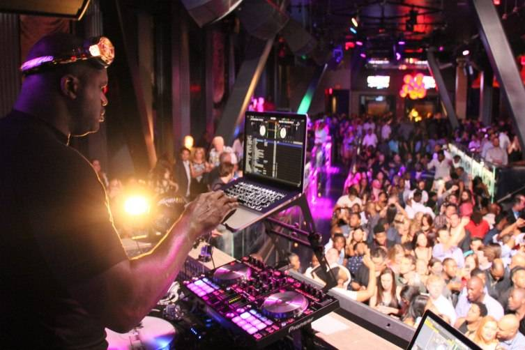 Shaq in the deejay booth at Chateau Nightclub