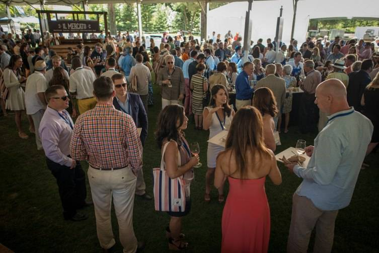 The guests inside the main tent at Meadowood during Auction Napa Valley.