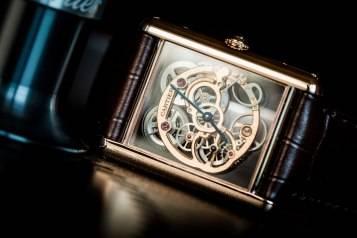 wpid-Cartier-Tank-Louis-Cartier-Skeleton-Sapphire-Watch-SIHH-2015-Front.jpg