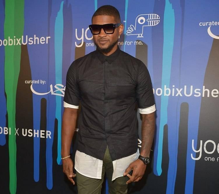 Usher celebrates charitable collaboration with yoobi hollywood ca july 09 musician usher attends yoobi x usher vip launch event m4hsunfo