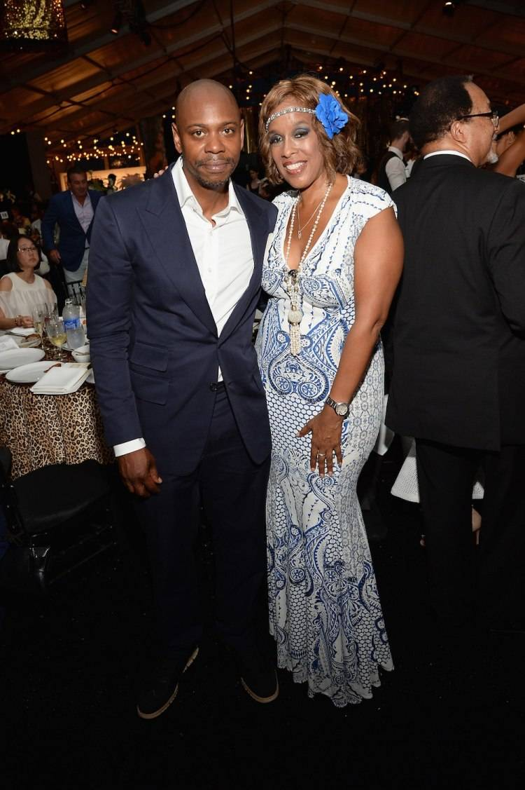 WATER MILL, NY - JULY 18:  Dave Chappelle and Gayle King attend as Russell Simmons' Rush Philanthropic Arts Foundation Celebrates 20th Anniversary At Annual Art For Life Benefit at Fairview Farms on July 18, 2015 in Water Mill, New York.  (Photo by Andrew Toth/Getty Images for Rush Philanthropic Arts Foundation)
