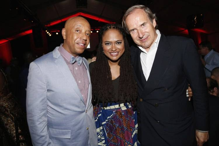 WATER MILL, NY - JULY 18:  Russell Simmons, Ava DuVernay and Simon de Pury attend as Russell Simmons' Rush Philanthropic Arts Foundation Celebrates 20th Anniversary At Annual Art For Life Benefit at Fairview Farms on July 18, 2015 in Water Mill, New York.  (Photo by Johnny Nunez/Getty Images for Rush Philanthropic Arts Foundation)