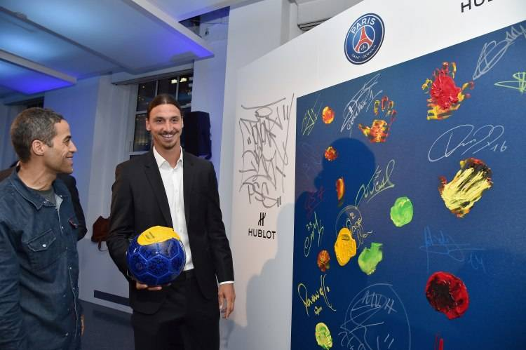 NEW YORK, NY - JULY 22:  JonOne and Zlatan Ibrahimovic attend the launch of Hublot's latest timepiece with Paris Saint-Germain Team and celebrates partnership In New York City on July 22, 2015 in New York City.  (Photo by Mike Coppola/Getty Images for Hublot)
