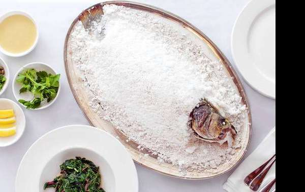 Fish in sea salt at Estiatorio Milos by Costas Spiliadis in Miami Beach