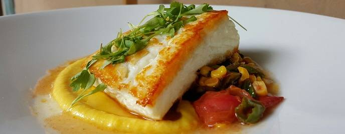 Halibut with corn, peppers and heirloom tomato