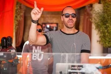 DJ Javier Alba kicks off the weekend at Tao Beach 7.17.15