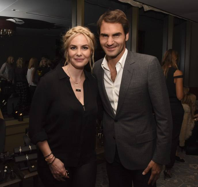 Nikki poses with Roger Federer at the launch party of her Established jewelry line in March