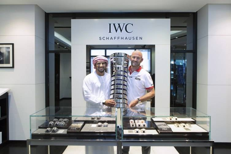 HANDOUT - Abu Dhabi, United Arab Emirates: Azzam Skipper Ian Walker (right) and teammate Adil Khalid (left) with their crew Abu Dhabi Ocean Racing (ADOR) made a final stopover at the IWC boutique in The Galleria on Al Maryah Island in Abu Dhabi, with the coveted Volvo Ocean Race trophy to celebrate the win. (PHOTOPRESS/IWC)