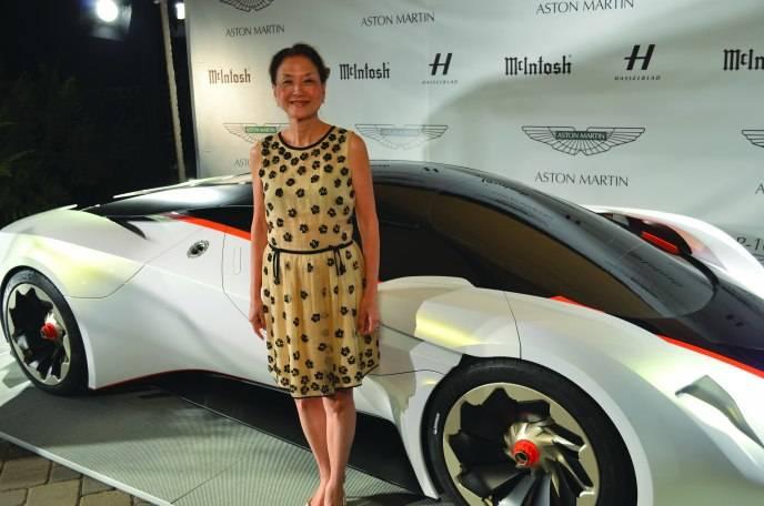 Olivia Hsu Decker next to Aston Martin DP 100