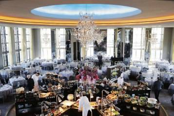 Chefs prepare a lavish spread of food before lunchtime guests arrive at the Rainbow Room, New York City's landmark restaurant atop 30 Rockefeller Plaza, Sunday, Oct. 5, 2014. The Rainbow Room reopened Sunday after a five-year absence. (AP Photo/Mark Lennihan)