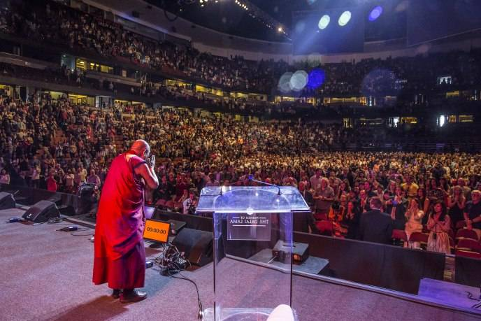 His Holiness bowing in gratitude at the sold out Honda Center crowd