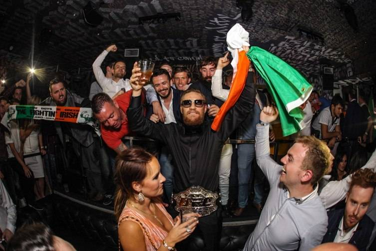 UFC Featherweight Conor McGregor celebrates at Foxtail Nightclub