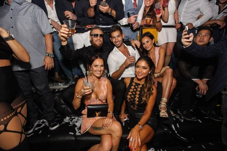 UFC Featherweight Conor McGregor celebrating with Arianny Celeste and friends at Foxtail Nightclub