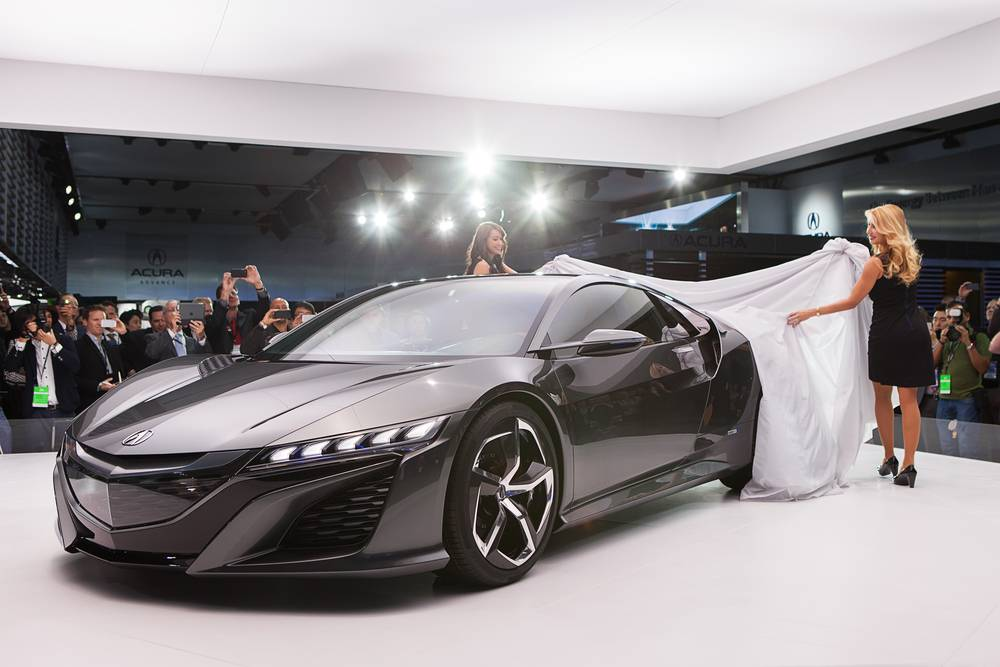 Spokesmodels unveil the new Acura NSX Concept II at The North American International Auto Show January 15, 2013 in Detroit, Michigan.