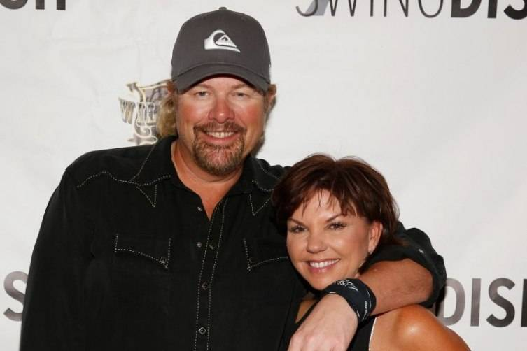 Recording artist Toby Keith (L) and SwingDish creator and designer Tricia Covel attend the SwingDish Launch Event at The Country Club at Wynn Las Vegas on August 18, 2015 in Las Vegas, Nevada