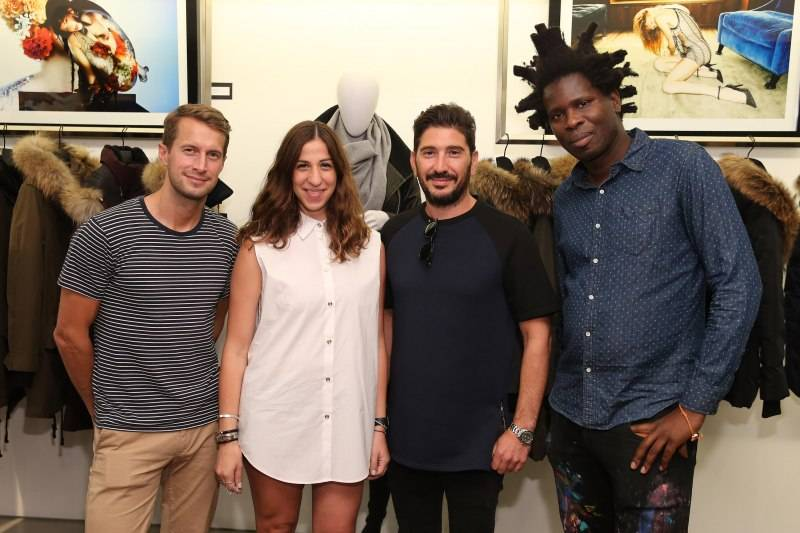 "NEW YORK, NY - AUGUST 19:  (L-R) DJ Brendan Fallis, Mackage Co-Creative Directors Elisa Dahan and Eran Elfassy and artist and curator Bradley Theodore attend the Mackage X Bradley Theodore presenting ""The Underground Artist"" curated art exhibition at Mackage Soho on August 19, 2015 in New York City.  (Photo by Neilson Barnard/Getty Images for Mackage)"