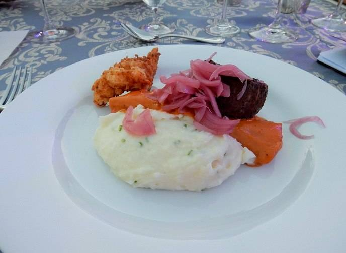 Barbecued spiced beef filet and chicken fried Maine lobster with loaded whipped potatoes