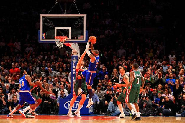 NEW YORK, NY - FEBRUARY 23:  Carmelo Anthony #7 of the New York Knicks shoots the ball over Andrew Bogut #6 of the Milwaukee Bucks at Madison Square Garden on February 23, 2011 in New York City. NOTE TO USER: User expressly acknowledges and agrees that, by downloading and/or using this Photograph, User is consenting to the terms and conditions of the Getty Images License Agreement. The Knicks defeated the Bucks 114-108.  (Photo by Chris Trotman/Getty Images) *** Local Caption *** Carmelo Anthony;Andrew Bogut