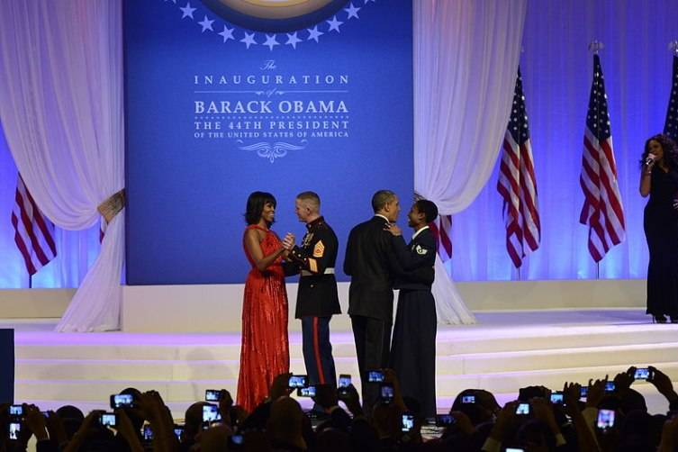 President Barack Obama dances wtih U.S. Air Force Staff Sgt. Bria Nelson, of Indianapolis, Ind., as First Lady Michelle Obama dances with Gunnery Sgt. Timothy Easterling, of Barnwell, S.C., during the Commander in Chief Inaugural Ball at the Walter E. Washington Convention Center in Washington, Jan. 21, 2013