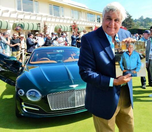 Jay Leno poses on the Concept Lawn at the  Pebble Beach Concours d'Elegance.