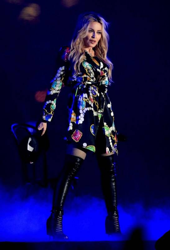 Recording artist Madonna performs onstage during the Coachella Music Festival wearing Moschino